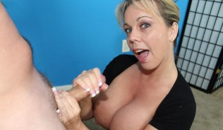 Amber Lynn Bach gives a handjob demonstration