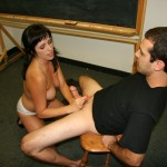 Dixie Comet jerks off her teacher in the classroom