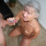 mature babe gets bathed in cum