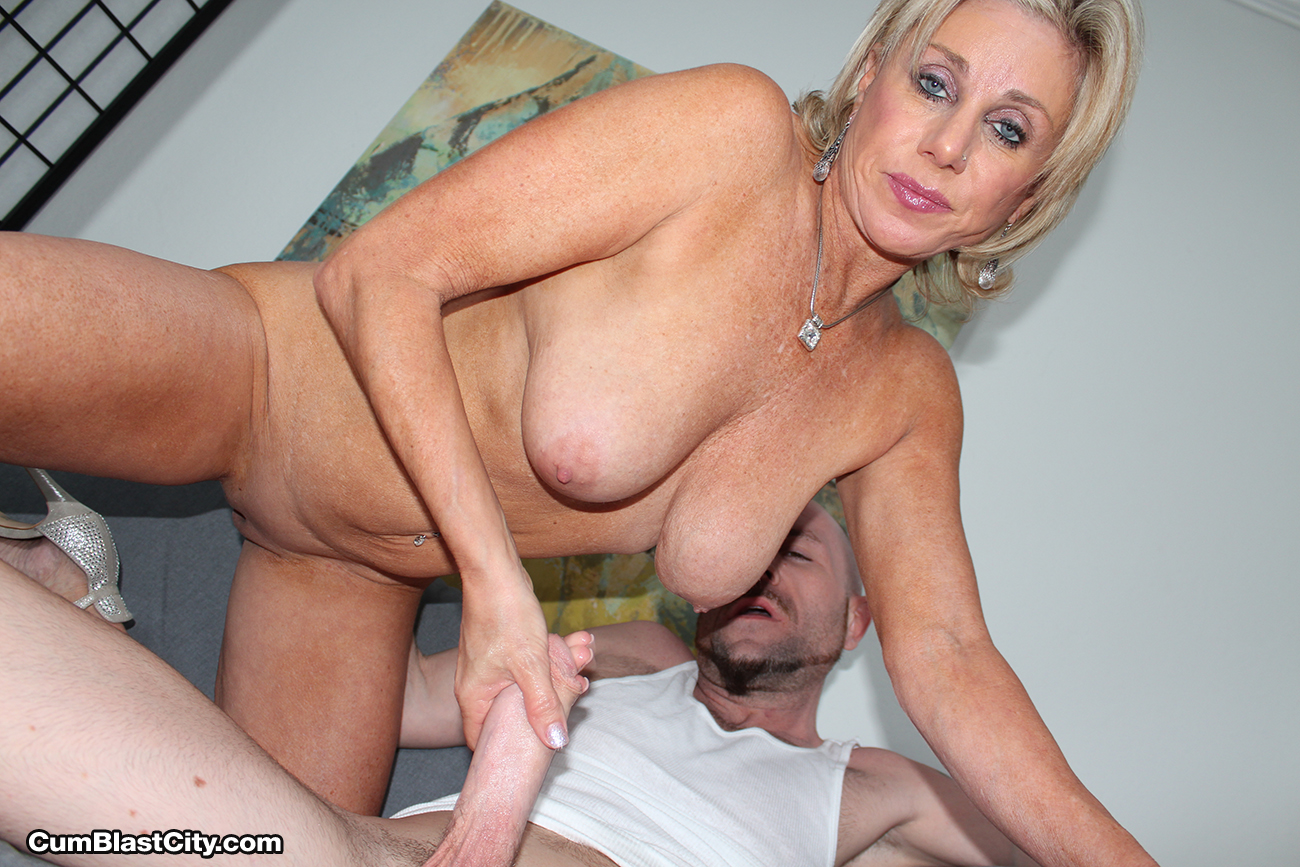 Naked mature women giving hand jobs
